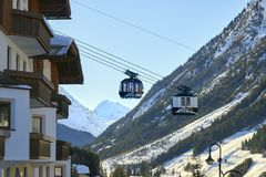 Modern aerial tramway in Austrian Alps ski resort. Ischgl, Austria - December 24, 2017: Modern aerial tramway in Austrian Alps ski resort. Highland cable car Royalty Free Stock Photography