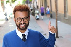 Modern afro businessman giving a thumbs up.  Stock Photography