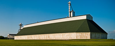 Modern Agriculture. A view of a barn influenced, modern agricultural storage facility near South Charleston, Ohio on a clear and sunny evening Stock Photos