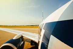 Modern aircraft wing and fuselage part landing taking off from m Stock Photography