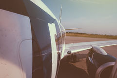 Modern aircraft wing and fuselage part landing taking off from m Royalty Free Stock Images