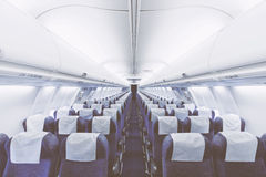 Modern Airplane seats in perspective. Transportation concept. Ai. Rcraft's corridor interior in modern tones Royalty Free Stock Image