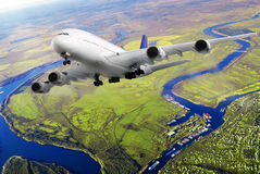 Modern airplane  in the sky near Airport. Royalty Free Stock Photo