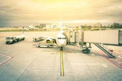 Modern airplane at the terminal gate in international airport Stock Photo