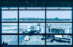 Modern airport with airplane at the terminal gate Royalty Free Stock Photo