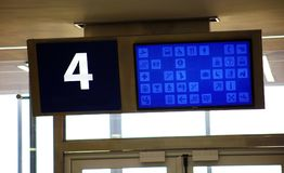 Modern airport departure gate waiting area with gate number. In big screen stock photo
