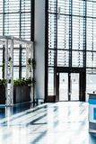 Modern airport hall with big windows and enter. Concept of contemporary airport royalty free stock images