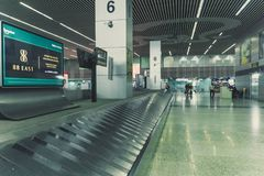 Modern airport hall interior with nobody. Empty airport premises without people. straight escalator on the floor Royalty Free Stock Photo