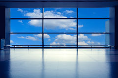 Modern airport interior glass wall aisle window Stock Images