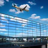Modern airport mirror glass wall. Blue sky reflected in modern airport mirror glass wall with flight stock photo