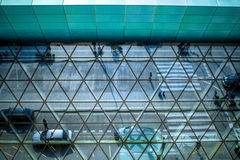 Modern airport terminal facade. With cars and people's reflections stock photography