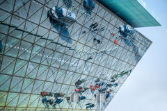 Modern airport terminal facade. With cars and people's reflections Stock Images