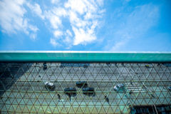 Modern airport terminal facade. With cars and people's reflections. Wide angle view with copy space Royalty Free Stock Photos