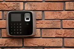 Modern alarm system with fingerprint scanner on wall. Space for text. Modern alarm system with fingerprint scanner on brick wall. Space for text royalty free stock photos