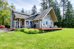 Modern American farm house with spring landscape. Royalty Free Stock Photo
