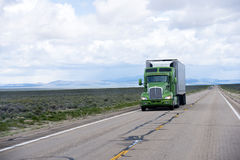 Modern American semi truck and reefer trailer on Nevada road Stock Image