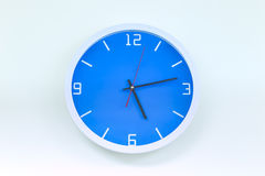 Modern analog wall clock isolate on white background.  Stock Images