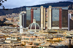 Modern and ancient buildings. A view of Genoa's roofs in Italy, with modern and ancient buildings and reflections on the skyscraper stock image