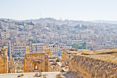 Modern and ancient Jerash, Jordan. Well preserved and restored ruins of Jerash (Gerasa, Greco-Roman city of Antiquity), Jordan with modern city in background Royalty Free Stock Image