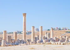 Modern and ancient Jerash, Jordan. Well preserved and restored ruins of Jerash (Gerasa, Greco-Roman city of Antiquity), Jordan with modern city in background Stock Photography