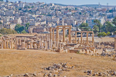 Modern and ancient Jerash, Jordan. Well preserved and restored ruins of Jerash (Gerasa, Greco-Roman city of Antiquity), Jordan with modern city in background Royalty Free Stock Photo