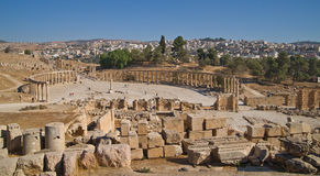 Modern and ancient Jerash, Jordan. Well preserved and restored ruins of Jerash (Gerasa, Greco-Roman city of Antiquity), Jordan with modern city in background Stock Photos