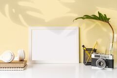 Free Modern And Stylish Workspace With White Frame Mock Up And Desk Office Supplies And Retro Camera With Color Background And Copy Royalty Free Stock Image - 210542816