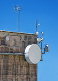 Modern antennas on an old industrial building Stock Images