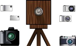 Modern and antique cameras. From huge wooden cameras of the past up to the recent ultrathin Stock Photo