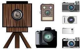 Modern and antique cameras. From huge wooden cameras of the past up to the recent ultrathin Stock Photography