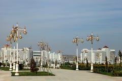 Modern apartamentes behind a young park. Turkmenistan Royalty Free Stock Photos