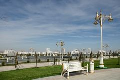 Modern apartamentes behind a young park. Turkmenistan Royalty Free Stock Photo
