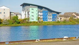 Modern apartment block by the river. Royalty Free Stock Image