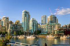 Modern Apartment Buildings along the Waterfront in Downtown Vancouver. Modern Apartment Blocks alonge False Creek in Downtown Vancouver at Sunset. Some Sunlit Royalty Free Stock Photo