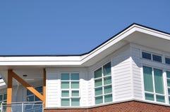 Modern Apartment Building. Macro modern apartment roof against blue sky Stock Photos