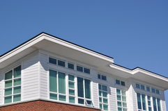 Modern Apartment Building. Macro modern apartment roof against blue sky Stock Images