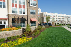 Modern apartment building. New modern apartment building with neat landscaping Royalty Free Stock Photos