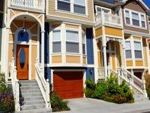Modern apartment building. Vivid colors, in Santa Cruz California. Small flower beds at entrance, garage, bay windows, stairs Stock Photos