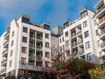 Modern Apartment Building with Autumn Trees Royalty Free Stock Photos