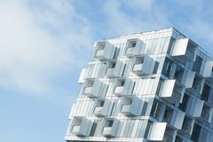 Modern apartment building with balconies. White abstract background of a modern apartment building with balconies Royalty Free Stock Photo