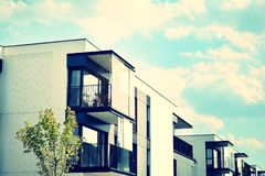 Modern apartment building exterior. Retro colors stylization royalty free stock photo