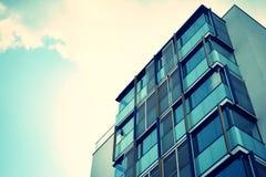 Modern apartment building exterior. Retro colors stylization stock image