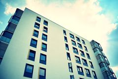 Modern apartment building exterior. Retro colors stylization stock photos