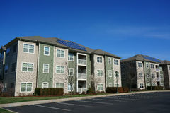 Modern apartment building exterior with solar panel Royalty Free Stock Photo