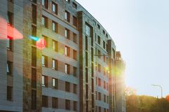 Modern apartment building exterior sunflare. Modern apartment building exterior concept. Sunshine sun flare stock photo