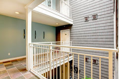 Modern apartment building hallway and door near railing. Royalty Free Stock Images