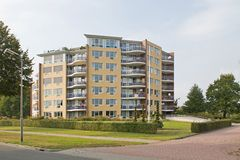 Modern apartment building in Hoogeveen in evening light, Netherlands Royalty Free Stock Images