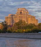 Modern apartment building on river bank. Modern apartment building on the bank of moscow river at sunset. Russia Royalty Free Stock Image