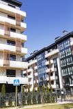 Modern apartment building in sunny day against blue sky.  royalty free stock photo