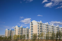 Modern apartment buildings. Under blue sky Stock Photos